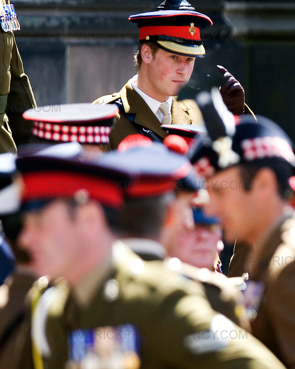Prince Harry takes  part  in a memorial to troops who fell during his tour of Afghanistan - on the day it was announced that four more British soldiers were killed in the country. The 23-year-old Household Cavalry officer joined 200 servicemen and women on Edinburgh's Royal Mile ahead of a service at the city's St Giles' Cathedral.