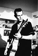 Man pulling a fierce face, plying the guitar, Brazil, 2000's