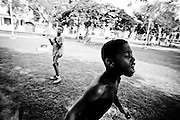 America, Cuba, Havana. a boy celebrates the triumph of his equipment after a street party of soccer in a public park. -02.07.2008, DIGITAL PHOTO, 49MB, copyright: Alex Espinosa/Gruppe28.