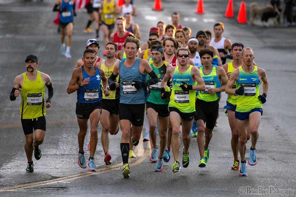 Elite runners head into Fair Oaks Village during the California International Marathon (CIM) in Fair Oaks Ca, Sunday Dec 3, 2017.<br /> photo by Brian Baer