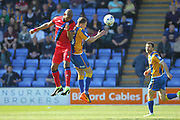 CAlvin Andrew clears the ball during the EFL Sky Bet League 1 match between Shrewsbury Town and Rochdale at Greenhous Meadow, Shrewsbury, England on 8 April 2017. Photo by Daniel Youngs.