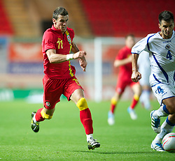 LLANELLI, WALES - Wednesday, August 15, 2012: Wales' Gareth Bale in action against Bosnia-Herzegovina during the international friendly match at Parc y Scarlets. (Pic by David Rawcliffe/Propaganda)