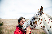 Tashina Redhawk with her horse on the Rosebud Indian Reservation.