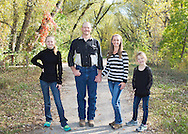 I love this family picture.  The fall color was beautiful, it was a warm morning and this family was such fun to photograph.  We are so lucky to live in Boulder County.  There are lots of fabulous locations to choose from.  While I love black and white pictures, this portrait had to be in color to capture the changing leaves.  The daughters were such characters, they were so fun to interact with.