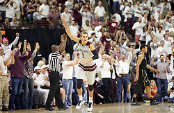 Texas A&M's D.J. Hogg (1) reacts after making a three point basket against Vanderbilt during the second half of an NCAA college basketball game, Saturday, March 5, 2016, in College Station, Texas. Texas A&M won 76-67. (AP Photo/Sam Craft)