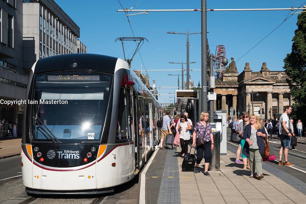Modern tram at stop on Princes Street in Edinburgh Scotland united Kingdom