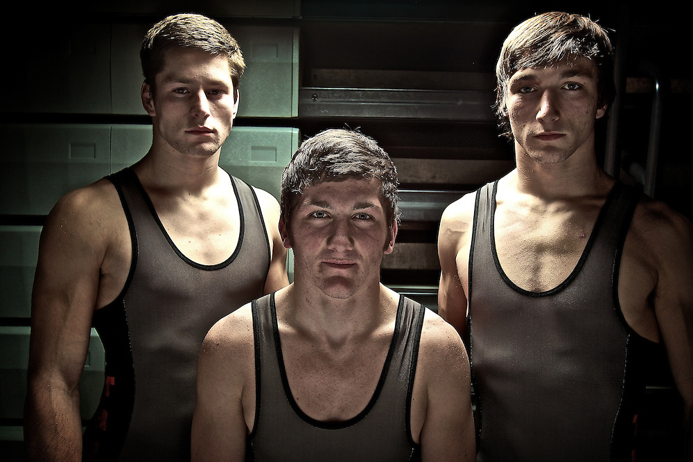 Returning Post Falls High School state wrestling champions Cole Jesienouski, from left, James Ost and Tyler Booth hope to make a run toward another set of individual titles and a state championship.