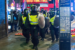 """© Licensed to London News Pictures. 28/07/2017. London, UK. Riot police try to take control of a riot situation seeking protesters on the streets of Dalston following the death of Rashan Charles whilst being arrested by police.  A statement from Scotland Yard said Mr Charles went into a shop, where he was seen """"trying to swallow an object"""" and it was then police officers struggled with him to make an arrest. Photo credit: Ray Tang/LNP"""