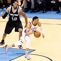 08 May 2016: Oklahoma City Thunder guard Russell Westbrook (0) is seen on a fast break past San Antonio Spurs forward LaMarcus Aldridge (12) during the Oklahoma City Thunder 111-97 victory over the San Antonio Spurs, during Game Four of the Western Conference Semifinals of the NBA Playoffs at the Chesapeake Energy Arena, Oklahoma City, Oklahoma, USA.