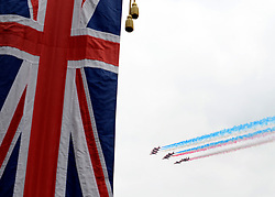 © Licensed to London News Pictures. 19/05/2012. WIndsor, UK The Red Arrows display team fly over Windsor. Armed Forces muster and parade in Windsor today , 19th May 2012, in tribute to Her Majesty the Queen for the Diamond Jubilee. 2,500 troops paraded through the town before the Queen and Duke of Edinburgh to mark the Diamond Jubilee. Once the parade has passed the Queen and Duke traveled along the same route to an arena within Home Park, where the troops mustered. A tri-service flypast of 78 aircraft, including helicopters, Hawks, the Battle of Britain Memorial Flight, the Red Arrows and Tornados went overhead. Photo credit : Stephen Simpson/LNP