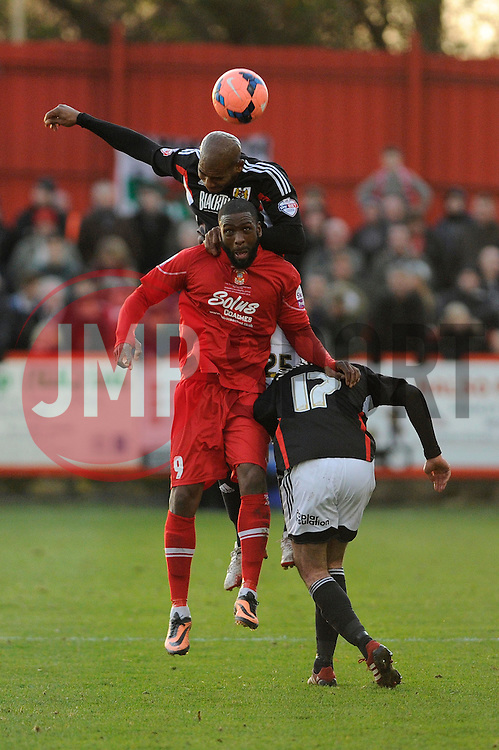 Bristol City's Marvin Elliott challenges Tamworth's Justin Richards to the header - Photo mandatory by-line: Dougie Allward/JMP - Tel: Mobile: 07966 386802 08/12/2013 - SPORT - Football - Tamworth - The Lamb Ground - Tamworth v Bristol City - FA Cup - Second Round