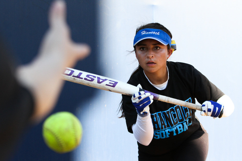 Allan Hancock College freshman Ashley Ruiz takes bunting practice before a game against Mexico National at Cal State Fullerton on Friday, Nov. 7, 2014. (Charles Hall/Sports Shooter Academy XI)