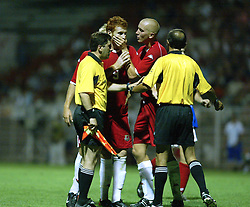 NOVI SAD, SERBIA -Tuesday, August 19th, 2003: Wales' Matthew Rees gags team-mate James Collins as he argues with referee Levan Paniashvill during the UEFA Under 21 European Championship Group 9 Qualifying match against Serbia & Montenegro at the Karadorde Stadium. (Pic by David Rawcliffe/Propaganda)
