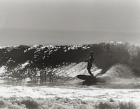 Another shot of Eric Arenson showing his classic form in this bottom turn at Rincon, 1965.