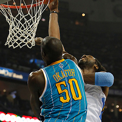 October 29, 2010; New Orleans, LA, USA;New Orleans Hornets center Emeka Okafor (50) defends against Denver Nuggets center Nene (31) of Brazil during the first half at the New Orleans Arena.  Mandatory Credit: Derick E. Hingle..