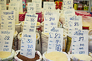 "26 SEPTEMBER 2012 - BANGKOK, THAILAND:  Varieties and grades of rice for sale in Khlong Toey Market in Bangkok. Khlong Toey (also called Khlong Toei) Market is one of the largest ""wet markets"" in Thailand. The market is located in the midst of one of Bangkok's largest slum areas and close to the city's original deep water port. Thousands of people live in the neighboring slum area. Thousands more shop in the sprawling market for fresh fruits and vegetables as well meat, fish and poultry. Thailand is the world's leading rice producer.    PHOTO BY JACK KURTZ"