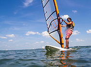 A student wind surfs on Lake Mendota at Memorial Union. Rentals are available through Outdoor UW, in 2014.