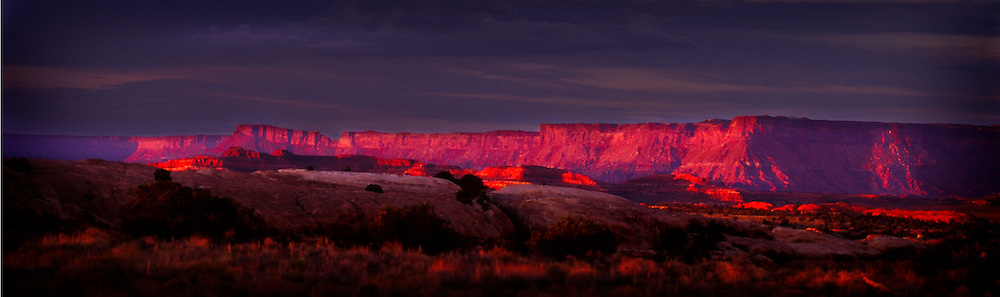 Sunset glow off east rim of Canyonlands, National Park, Utah.  Shot from Squaw Flat