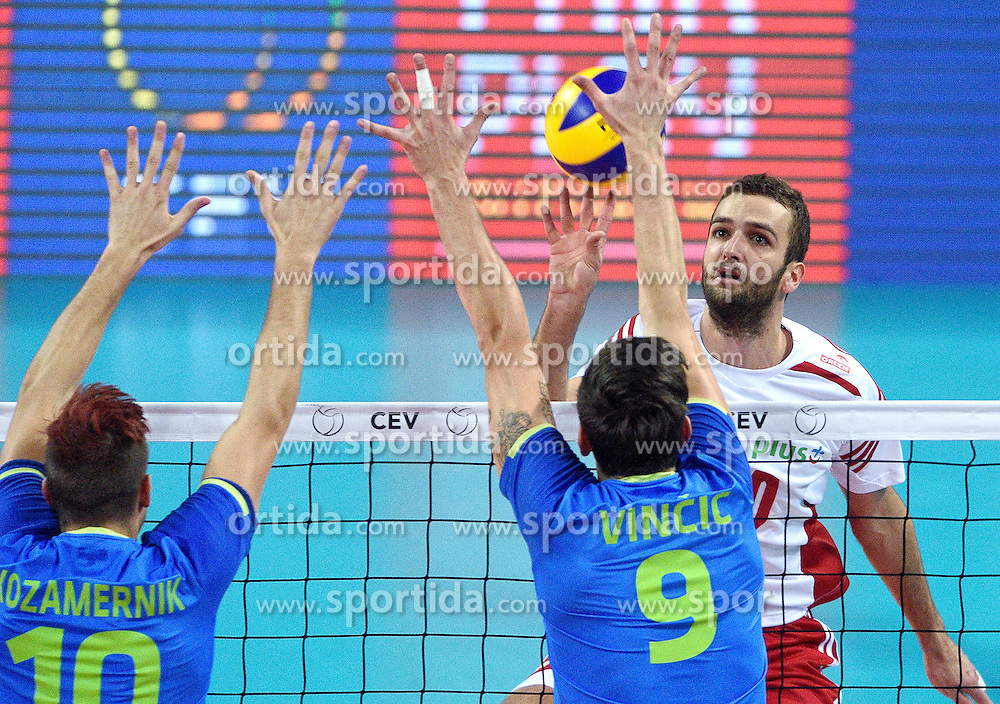 Mateusz Mika #20, Dejan Vincic #9, Jan Kozamernik #10 during volleyball match between National teams of Poland and Slovenia in Quarterfinals of 2015 CEV Volleyball European Championship - Men, on October 14, 2015 in Arena Armeec, Sofia, Bulgaria. Photo by Ronald Hoogendoorn / Sportida