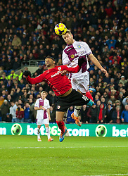 CARDIFF, WALES - Tuesday, February 11, 2014: Cardiff City's Fraizer Campbell and Aston Villa's Nathan Baker during the Premiership match at the Cardiff City Stadium. (Pic by David Rawcliffe/Propaganda)