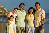 Family with girl (7-9) on beach (portrait)