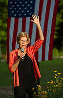 Senator Elizabeth Warren speaks to the crowd gathered at the home of Edie and Paul DesMarais for a House Party in Wolfeboro Wednesday evening.  (Karen Bobotas/for the Laconia Daily Sun)