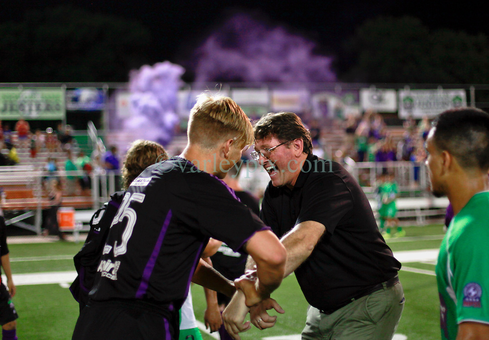 13 June 2015. New Orleans, Louisiana.<br /> National Premier Soccer League. NPSL. <br /> Manager Kenny Farrell enjoys the win as the New Orleans Jesters take a 3-2 victory against Texas' Premier Soccer League&rsquo;s (TPSL) runner-up, the Houston Hurricanes at home in the Pan American Stadium.<br /> Photo; Charlie Varley/varleypix.com