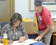 Karen Kingsley (left) of Pipersville, Pennsylvania and William Mumbauer of Doylestown, Pennsylvania of the Bucks County Board of Elections conduct the official tally for the 2015 general election Friday November 6, 2015 in Doylestown, Pennsylvania.  (Photo by William Thomas Cain)