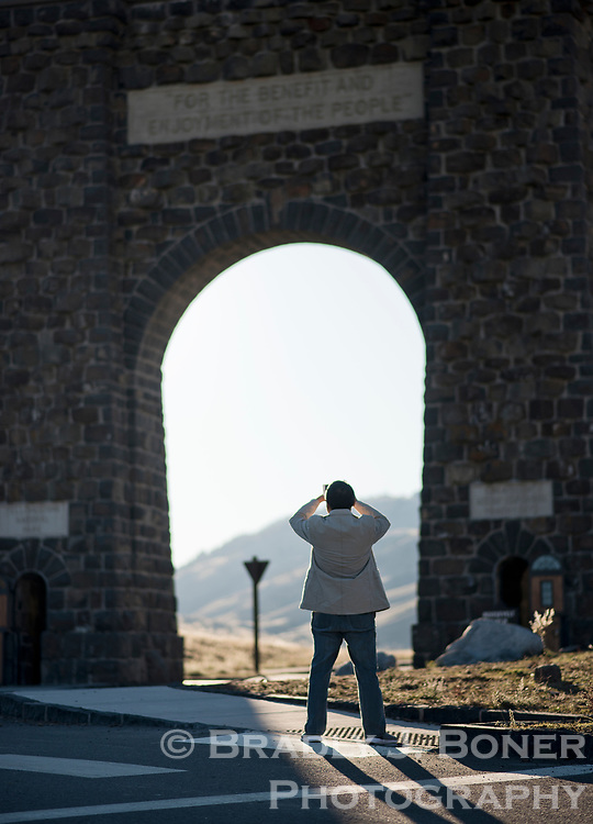 A visitor to Yellowstone National Park snaps a photo of the Roosevelt Arch at the park's North Entrance last week. The arch was built in 1903 and President Roosevelt, who was visiting Yellowstone that year, was asked to place the structure's cornerstone, which then took his name. The inscription at the top of the arch is from the Organic Act of 1872, the legislation that created Yellowstone National Park.