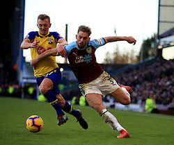Southampton's James Ward-Prowse (left) and Burnley's Charlie Taylor battle for the ball.