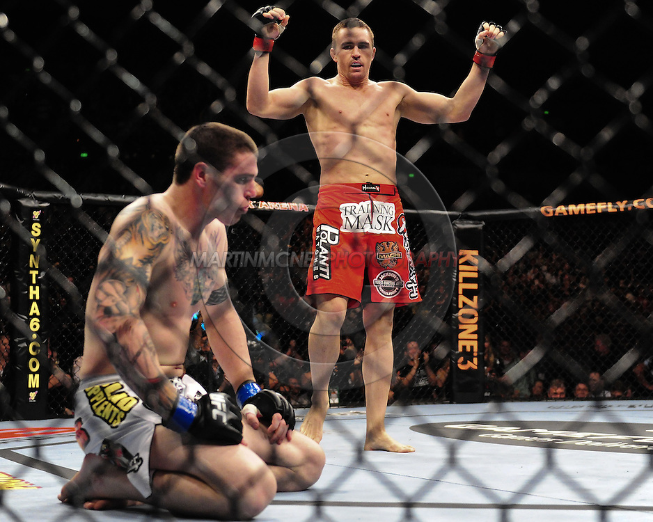 "SYDNEY, AUSTRALIA, FEBRUARY 27, 2011: Kyle Noke (standing) celebrates after defeating Chris Camozzi at ""UFC 127: Penn vs. Fitch"" inside Acer Arena in Sydney, Australia on February 27, 2011."