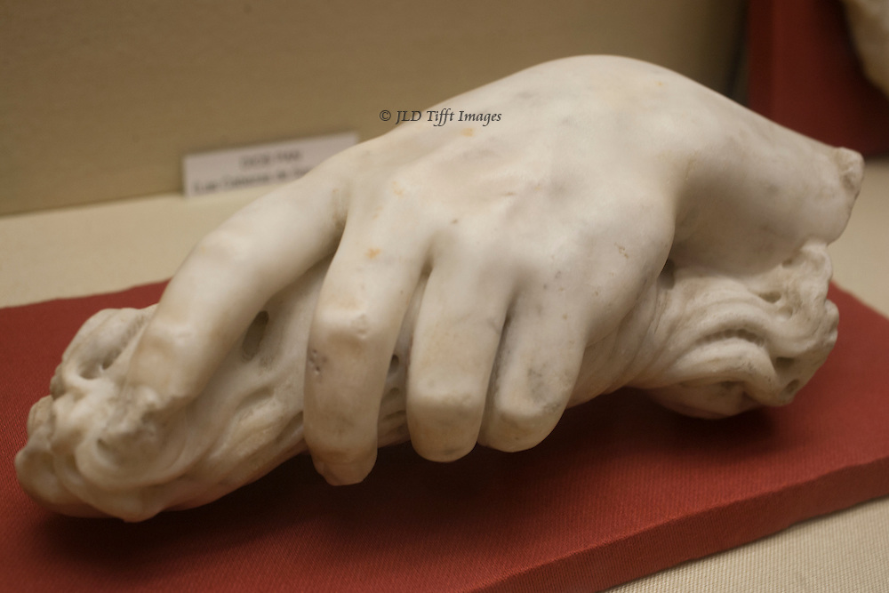 Marble fragment from an ancient Roman sculpture: a beautifully wrought hand gently grasping a length of rope (?)