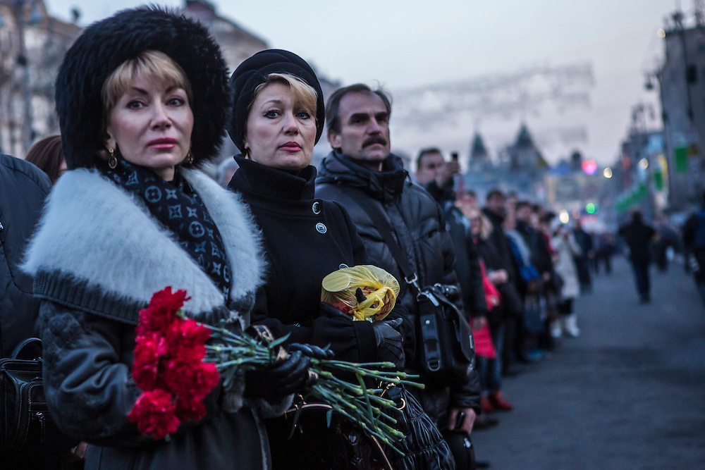 KIEV, UKRAINE - FEBRUARY 21: Women stand along the path of a funeral procession for two anti-government protesters killed in fighting with police on February 21, 2014 in Kiev, Ukraine. After a week that saw new levels of violence, with dozens killed, opposition and government representatives reached an agreement intended to resolve the crisis. (Photo by Brendan Hoffman/Getty Images) *** Local Caption ***