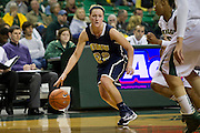 WACO, TX - DECEMBER 12:  Jaci Bigham #22 of the Oral Roberts University Golden Eagles drives to the basket against the Baylor University Bears on November 13, 2012 at the Ferrell Center in Waco, Texas.  (Photo by Cooper Neill/Getty Images) *** Local Caption *** Jaci Bigham