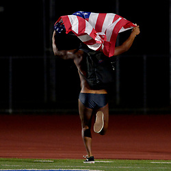 A streaker runs across the field carrying a American flag in the second half of a prep football game between South Hills and Charter Oak at Charter Oak High School in Covina, Calif., on Friday, Sept. 22, 2017. (Photo by Keith Birmingham, Pasadena Star-News/SCNG)