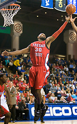 February 27, 2010; San Jose, CA, USA;  Fresno State Bulldogs forward Sylvester Seay (30) reaches for a rebound against the San Jose State Spartans during the first half at The Event Center.  San Jose State defeated Fresno State 72-45.