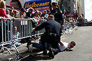New Orleans, Louisiana. United States. February 28th 2006..The Police arrests a man and his girlfriend for trying to get on the otherside of the barrier during the Zulu Parade on Canal Street.