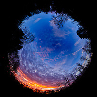 Fulll Sky View. Colorful Clouds at Dawn. Composite of 26 images taken with a Fuji X-T2 camera and 8-16 mm f/2.8 lens (ISO 200, 16 mm, f/5.6, 1/60 sec). Raw images processed with Capture One Pro and AutoPano Giga Pro (Inverse Little Planet)