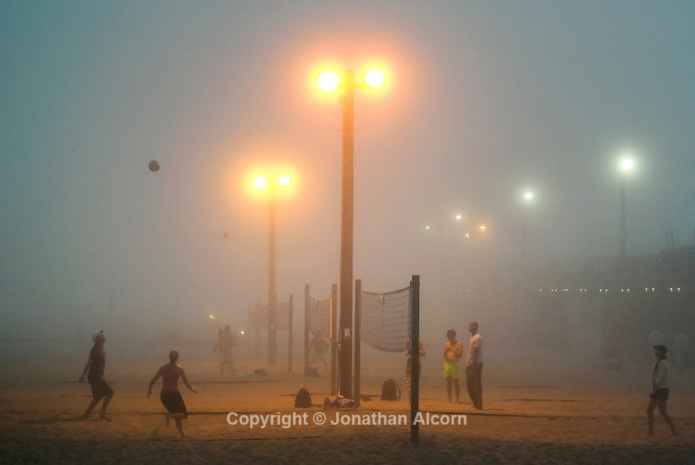 Fog fills at the air at the volleyball courts adjacent to the Santa Monica pier.