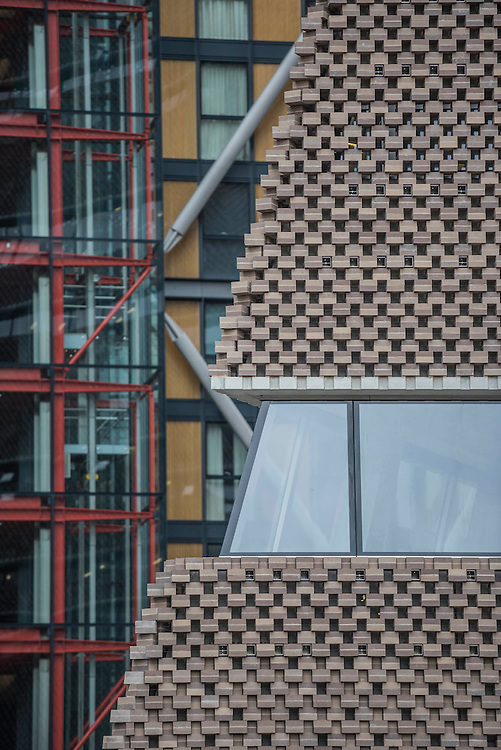 The new Tate Modern will open to the public on Friday 17 June. The new Switch House building is designed by architects Herzog & de Meuron, who also designed the original conversion of the Bankside Power Station in 2000.