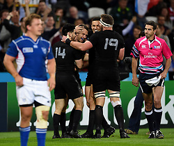Ben Smith of New Zealand is congratulated on his try - Mandatory byline: Patrick Khachfe/JMP - 07966 386802 - 24/09/2015 - RUGBY UNION - The Stadium, Queen Elizabeth Olympic Park - London, England - New Zealand v Namibia - Rugby World Cup 2015 Pool C.