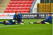 AFC Wimbledon goalkeepers, including Nik Tzanev of AFC Wimbledon (13) warming up during the EFL Sky Bet League 1 match between Fleetwood Town and AFC Wimbledon at the Highbury Stadium, Fleetwood, England on 10 August 2019.