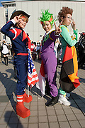 """Cosplayers dressed up as characters from the anime """"SAVER FORMULA"""". """"Bleed Kaga"""" (L), """"Jackie Gudelhian"""" (C) & """"Franz Heinel"""". TOKYO COMIC MARKET """"COMIKET"""" the biggest comic market in Japan. Independent designers come to sell their comics, there is anime, manga, cosplay, toys, posters etc. At """"Tokyo Big Sight"""" exhibition center."""