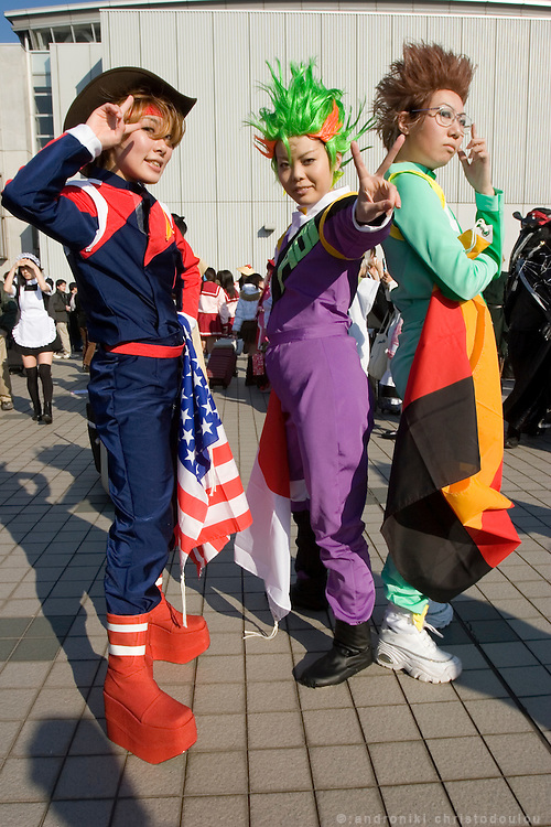 "Cosplayers dressed up as characters from the anime ""SAVER FORMULA"". ""Bleed Kaga"" (L), ""Jackie Gudelhian"" (C) & ""Franz Heinel"". TOKYO COMIC MARKET ""COMIKET"" the biggest comic market in Japan. Independent designers come to sell their comics, there is anime, manga, cosplay, toys, posters etc. At ""Tokyo Big Sight"" exhibition center."