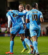Jean-Yves Mvoto (left) of Barnsley celebrates scoring the opening goal with Ryan McLaughlin of Barnsley (2nd left), Liam Lawrence of Barnsley (3rd left) and Chris O'Grady of Barnsley during the Sky Bet Championship match at The Valley, London<br /> Picture by David Horn/Focus Images Ltd +44 7545 970036<br /> 15/04/2014
