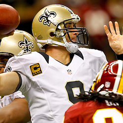 September 9, 2012; New Orleans, LA, USA; New Orleans Saints quarterback Drew Brees (9) against the Washington Redskins during the first quarter of a game at the Mercedes-Benz Superdome. Mandatory Credit: Derick E. Hingle-US PRESSWIRE