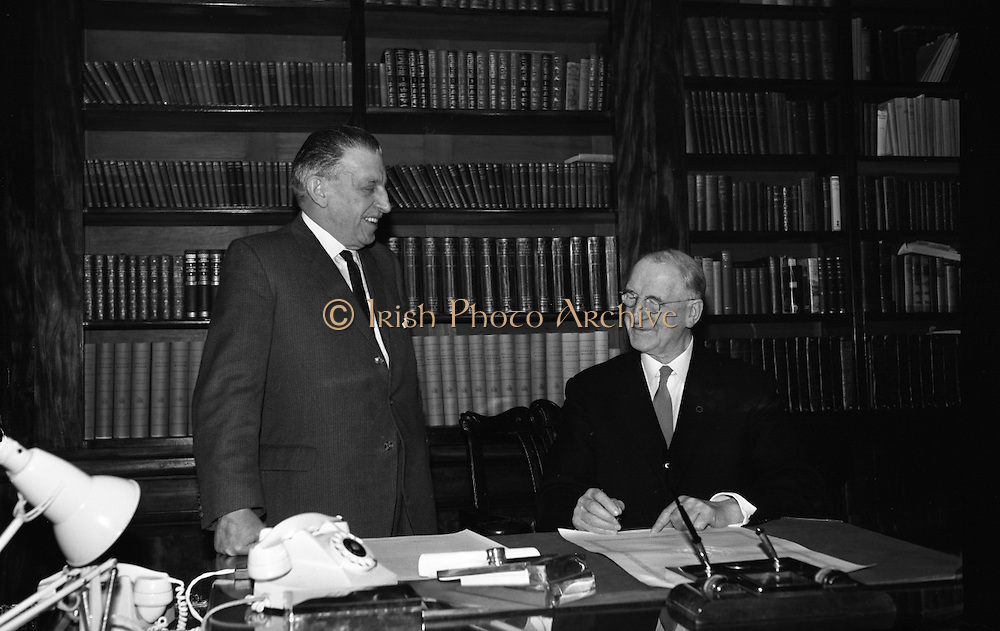 Dissolution of Dáil Eireann..1965..18.03.1965..03.18.1965..18th March 1965..The proclaimation to dissolve the Dail was signed by President Eamon de Valera and An Taoiseach Seán Lemass at a short formal ceremony at Áras an Uachtarain...Image shows President Eamon DeValera signing the dissolution order as At Taoiseach, Mr Sean Lemass TD looks on.