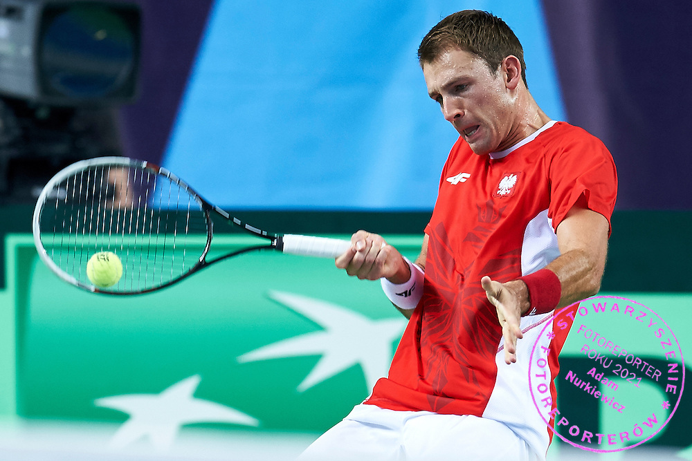 Lukasz Kubot of Poland in action during first day the Davies Cup / Group I Europe / Africa 1st round tennis match between Poland and Lithuania at Orlen Arena on March 6, 2015 in Plock, Poland<br /> Poland, Plock, March 6, 2015<br /> <br /> Picture also available in RAW (NEF) or TIFF format on special request.<br /> <br /> For editorial use only. Any commercial or promotional use requires permission.<br /> <br /> Mandatory credit:<br /> Photo by &copy; Adam Nurkiewicz / Mediasport