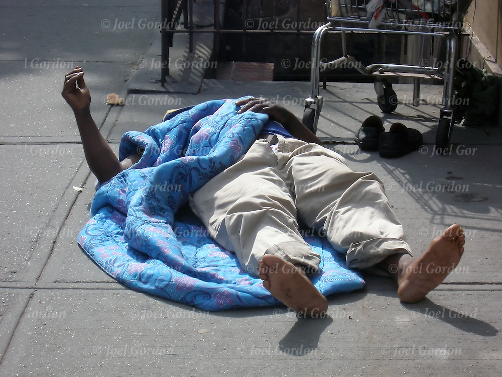 Homeless street person either sleeping on New York City street corner