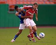 July 1, 2007 - Kansas City, MO..Toronto FC midfielder Ronnie O'Brien (front) gets held from behind by Kansas City Wizards defender Jose Burciaga Jr.(back) in the first half at Arrowhead Stadium in Kansas City, Missouri on July 1, 2007...MLS:  The Toronto FC and Wizards ended in a 1-1 tie.  .Photo by Peter G. Aiken / Cal Sport Media
